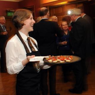 waitress serving canapes