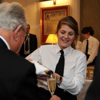 waitress serving a drink